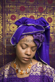 Young African American Woman in Traditional African Dress With Eyes Closed
