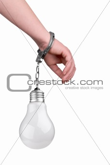 One hand handcuffed to a incandescent lightbulb