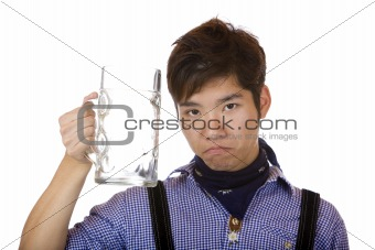 Asian look sad, with empty Oktoberfest beer stein