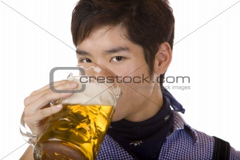 Young man drinking out of Oktoberfest beer stein (Mass)