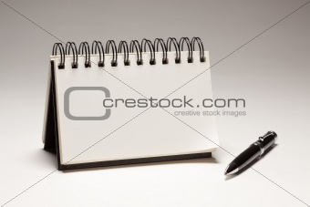Blank Spiral Note Pad and Pen on a Gradated Background.