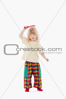 boy with long blond hair using comb - isolated on white