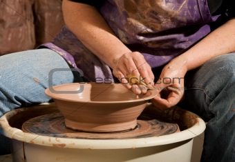 Potter Shaping Clay