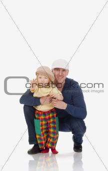 father and son with caps smiling and waving - isolated on white