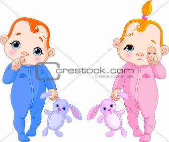 Cute babies going to sleep