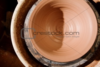 Clay bowl on potters wheel
