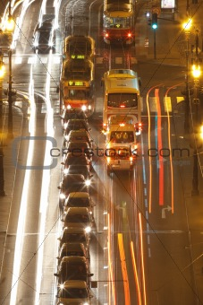 prague - high angle view of traffic on cechuv bridge at dusk