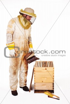 Beekeeper Smoking A Hive