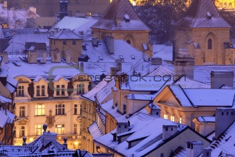 prague - winter view of lesser town rooftops covered with snow