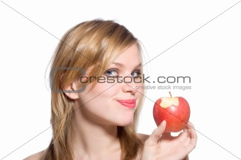 blonde woman holding a red apple which has been bitten into