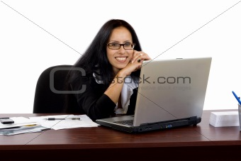 business woman working at her desk with a laptop
