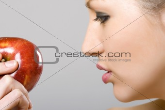 woman looking at an apple