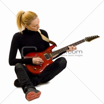 girl playing an electric guitar sitting down