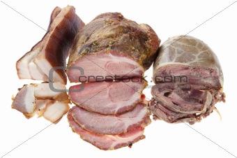 Cutting smoked sausage and pork gammon