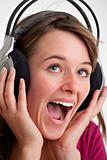 young woman screams for joy while listening to music