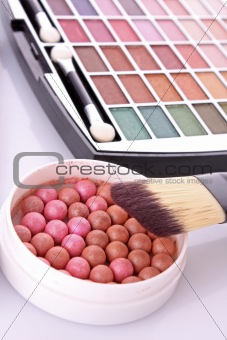 cosmetic brushes  brush , eye shadows and rouge  on white  backg