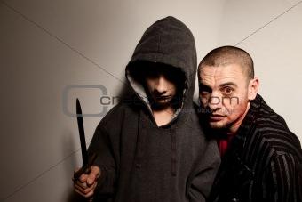 Evil boy and zombie sidekick