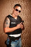 Hispanic Cop Holding Gun