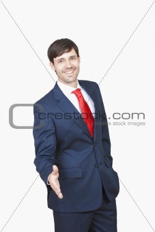 business executive in suit stretching out his hand for handshake