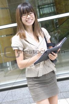 asian business women over a folder
