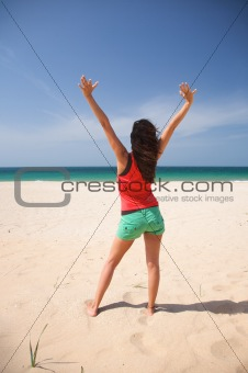 green shorts woman arms up