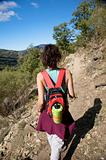red rucksack woman walking in mountain