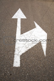 arrows on asphalt