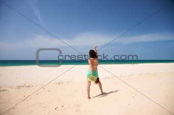 barefoot woman dance at beach