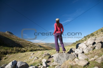 relaxed woman on a rock