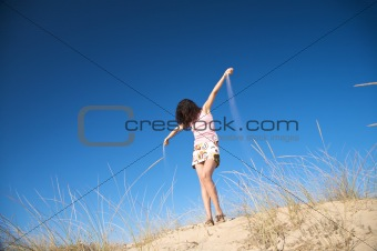 woman hands with sand