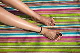 woman legs on striped towel