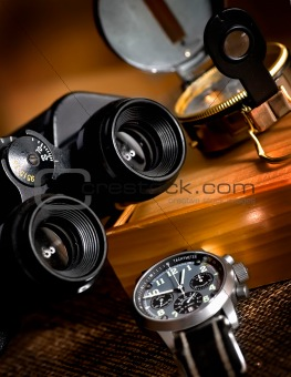 the composition with chronograph, binocular and compass