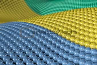 Wave of spheres in the colors of Gabon