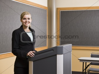 Young Woman Standing at Podium Smiling