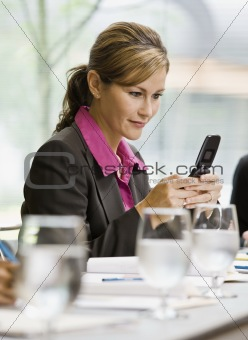 Businesswoman Texting with Cell Phone