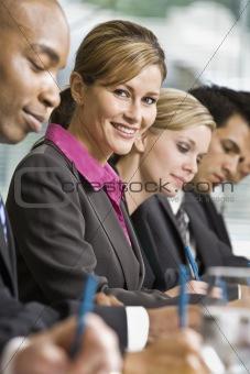 Businesswoman at Meeting Smiling