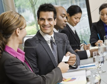 Businessman at Meeting Smiling