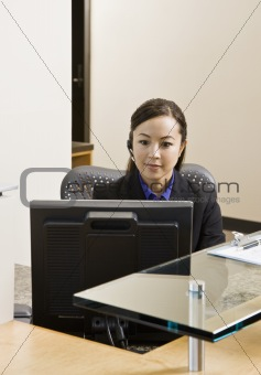 Young woman at Computer