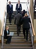 Businesswoman Sitting on Stairs