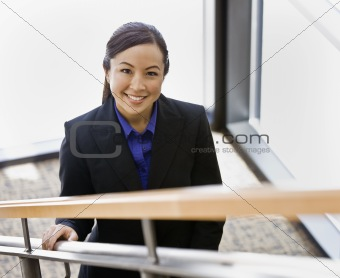 Young Businesswoman on Stairs Smiling