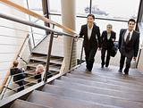 Business People Traversing Stairs