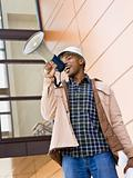 Male Construction Worker Using Bullhorn