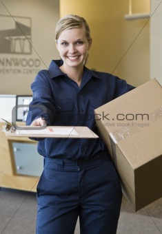 Young Woman Delivering Box