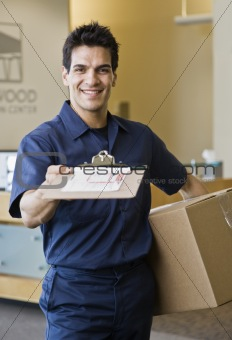 Young Man Delivering Box