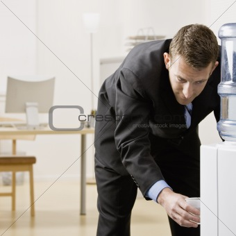 Businessman at Water Cooler