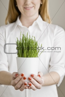Young Woman with Potted Plant
