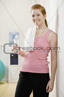 Young Woman Drinking Water After Exercising