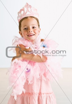 Young girl wearing crown and feather boa