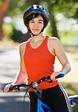 Woman on bike smiling