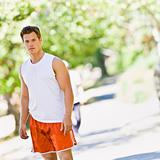 Runner standing in park